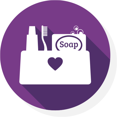 a white icon of a bag of toiletries on purple background